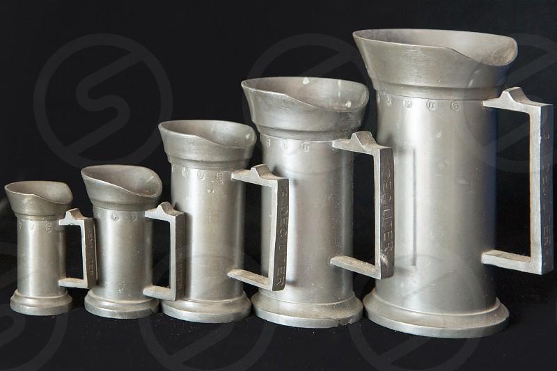 Tin measuring cups photo
