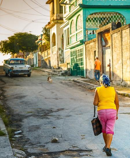 Woman walking up a street in a province outside of Havana Cuba photo