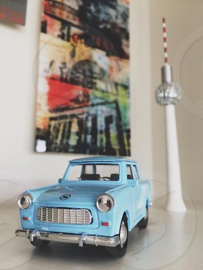 Blue model trabant car model East Berlin TV tower and berlin photos souvenirs photo