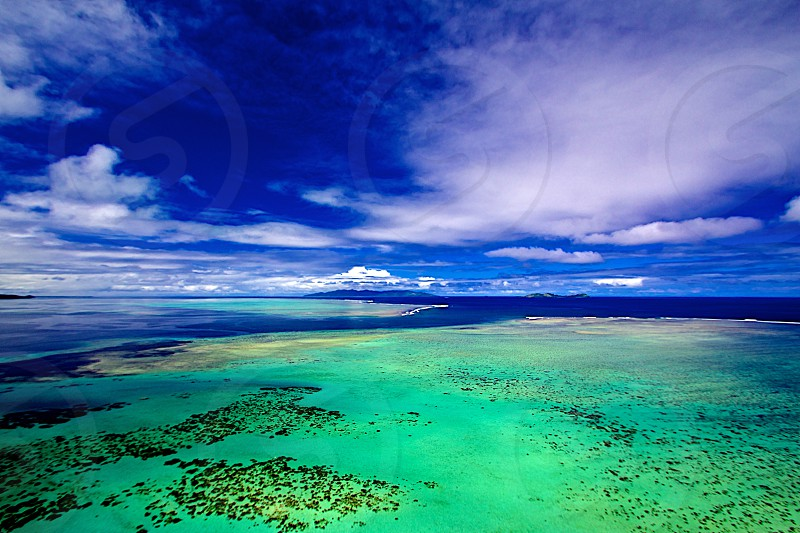 Reef and outer islands taken from ultra-light air craft just off the coast of Viti Levu Fiji. photo
