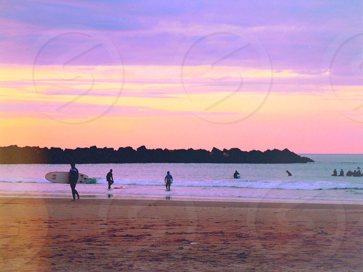 Spain Basque Country San Sebastián Atlantic ocean adventure geography natural nature water waves surfing surf surfers reds pinks purples photo
