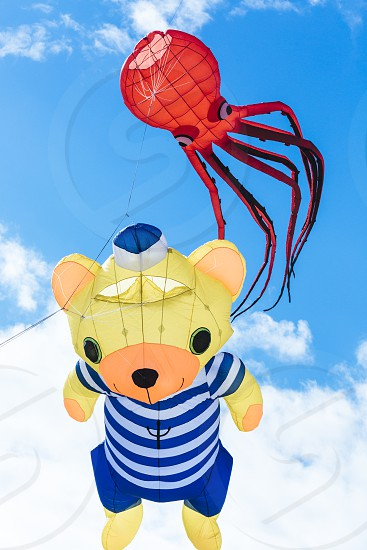 Flying kite with red Octopus-shaped and bear animal  photo