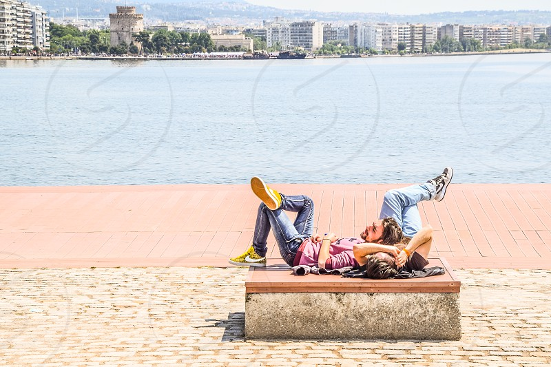 Young People Lying/Resting On The Dock photo