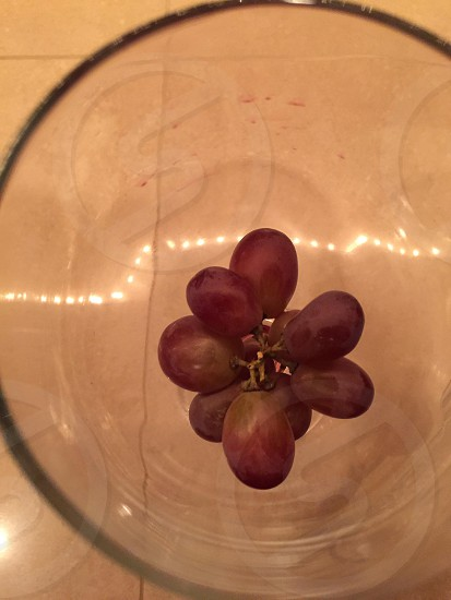 Grapes inside a wine glass photo