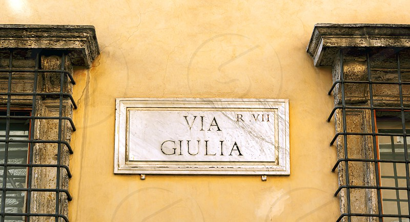 The indication of the Via Giulia address in an old marble sign in Rome. photo