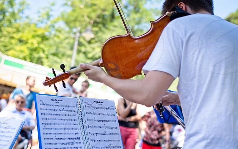 Violin music music sheet performance person art street urban artist city musicians people outdoors leisure sense sound playing audience spectators public photo