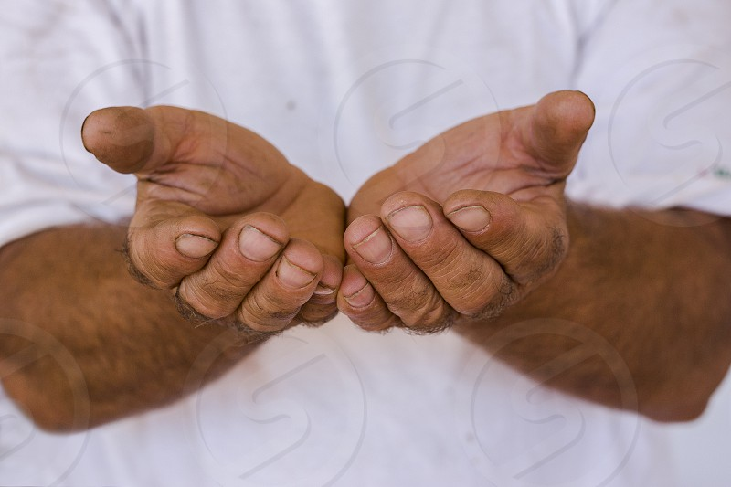 male hands hard work agriculture effort dirt damaged nothing empty begging poverty help asylum immigrant refugee photo