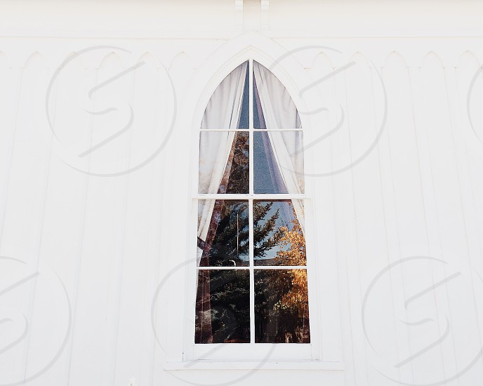 clear glass window with white curtains photo