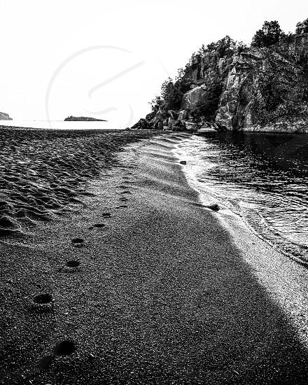 Footprints black sand beach Lake Superior Minnesota photo