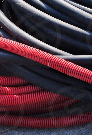red plastic electrical hose photo