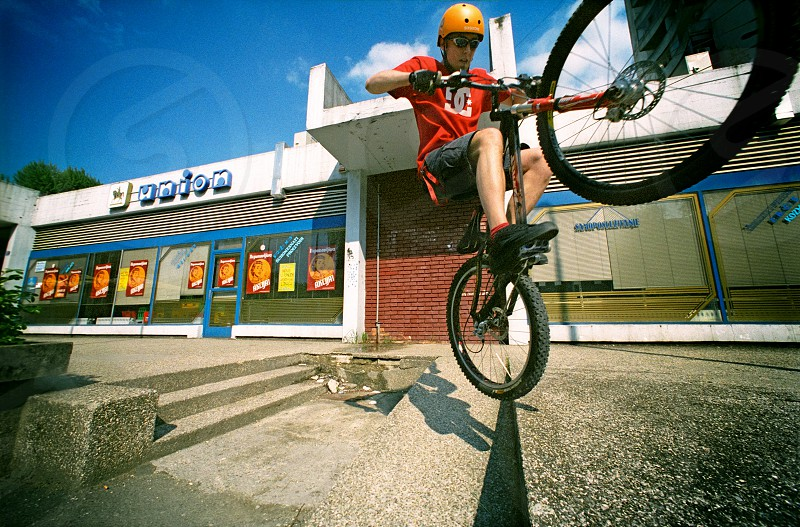 trials bike helmet gloves jump pedal kick photo