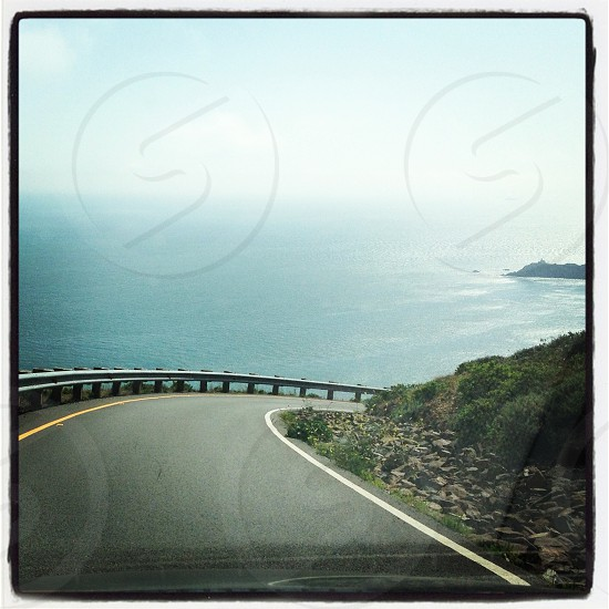 Driving the pacific coastline.  ( beach ocean driving scenic pacific ) photo