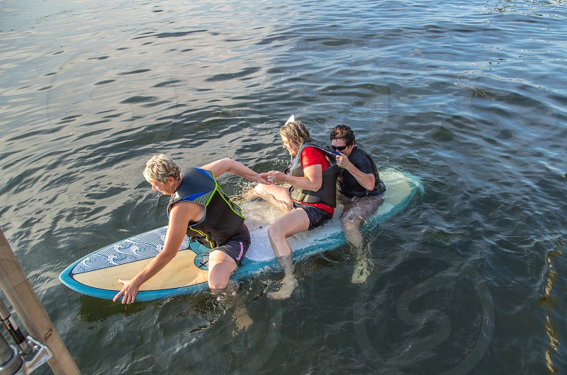 Three's a crowd on a paddle board photo