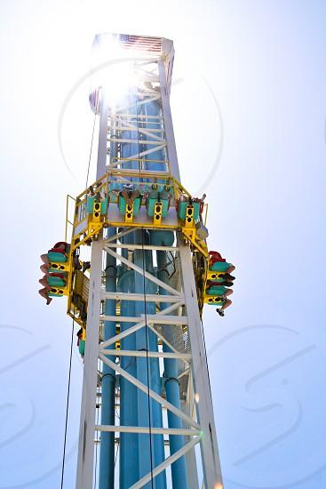people enjoying rides in high rise tower during daytime photo