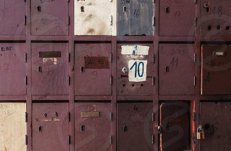 Retro look of an old wooden postal boxes damaged but still in use. photo