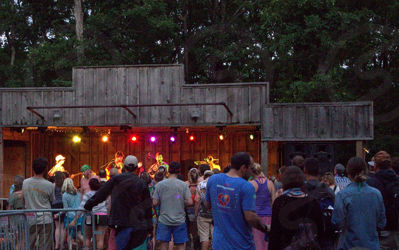 Outdoor concert at wooden stage photo
