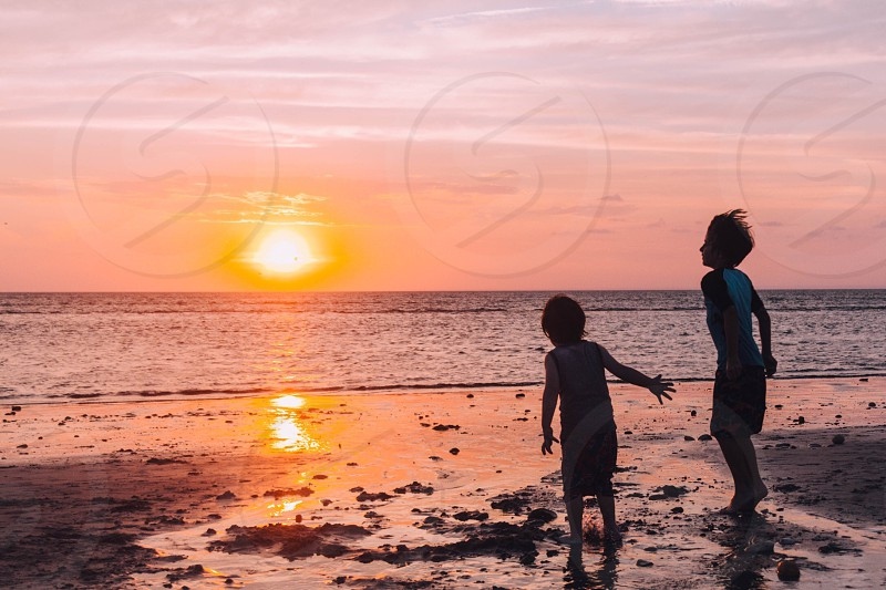 Beach sunset ocean water kids sun sand photo