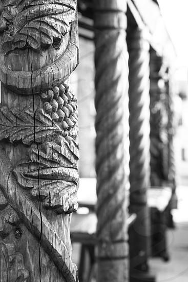 Black and white rustic wood pillars. photo