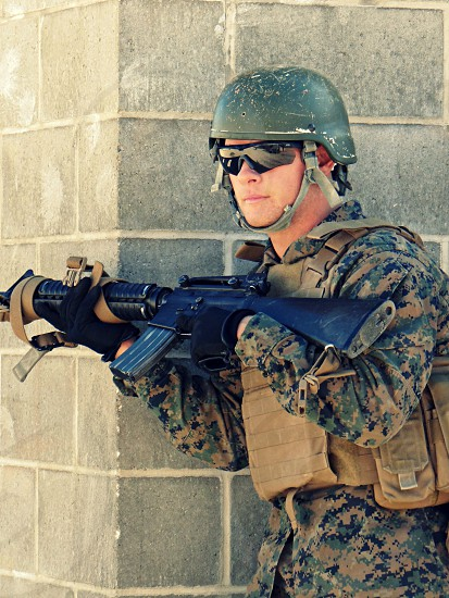 soldier holding black assault rifle photo