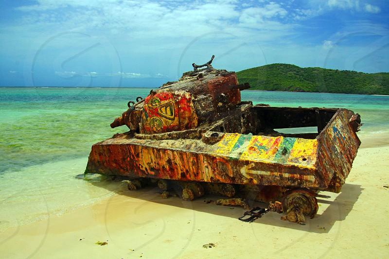 metal tank sitting on beach photo