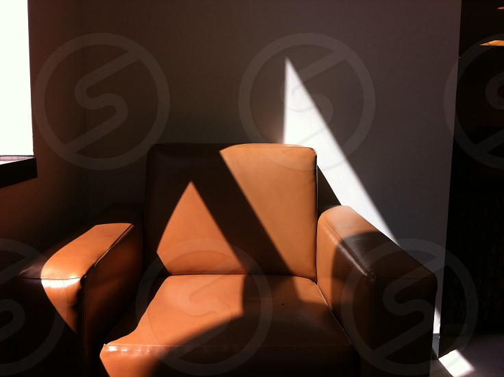 brown padded arm chair photo