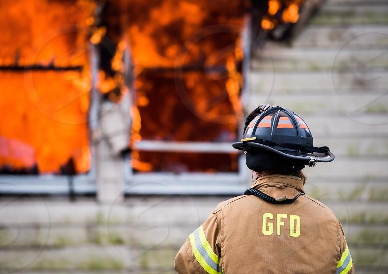 Firefighter fire danger burning house  photo