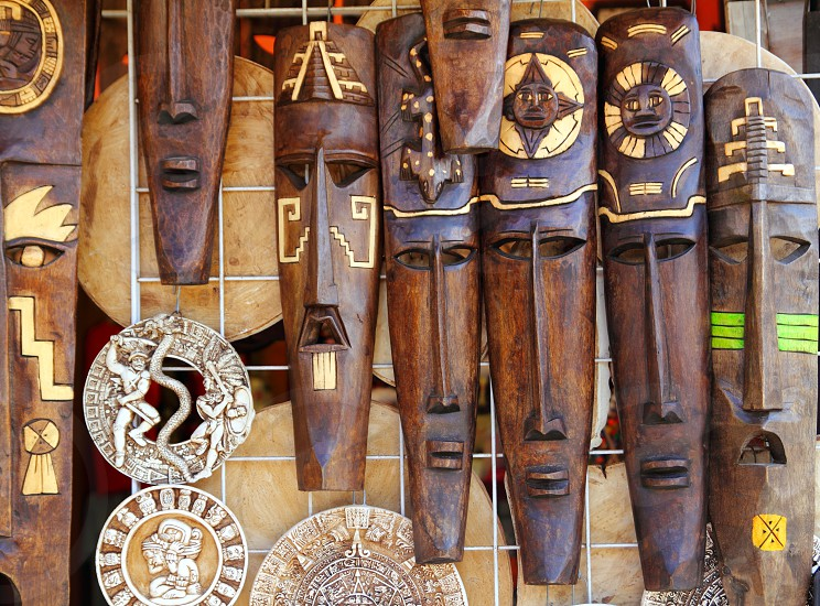 aztec mayan wooden Mexican indian mask handcrafts in rows photo