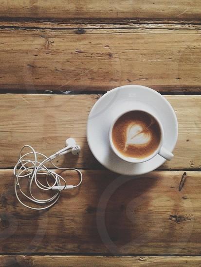 Espresso drink and headphones photo