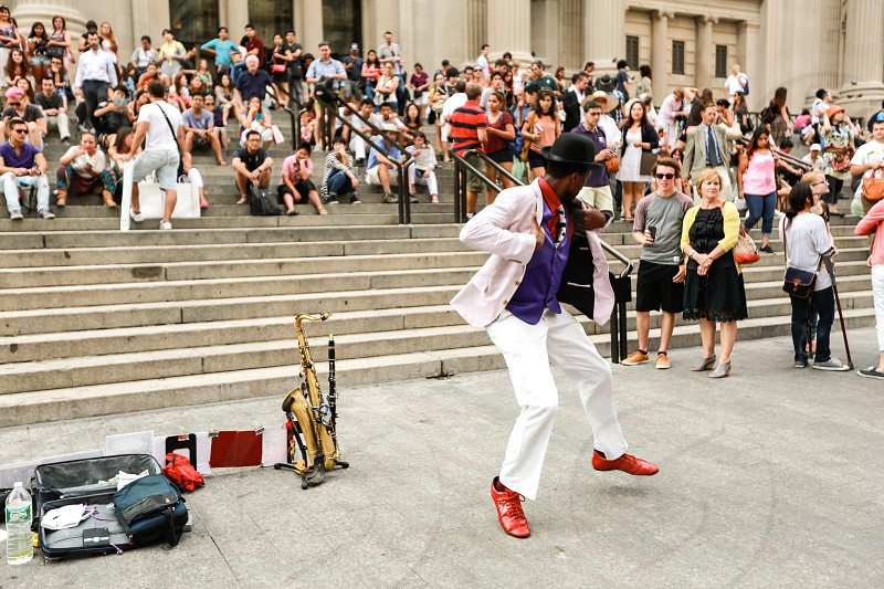 Street performer entertaining and amusing all of the visitors of the MET in NYC. photo