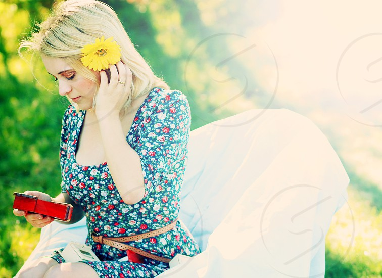 woman with yellow flower hair ornament sitting photo