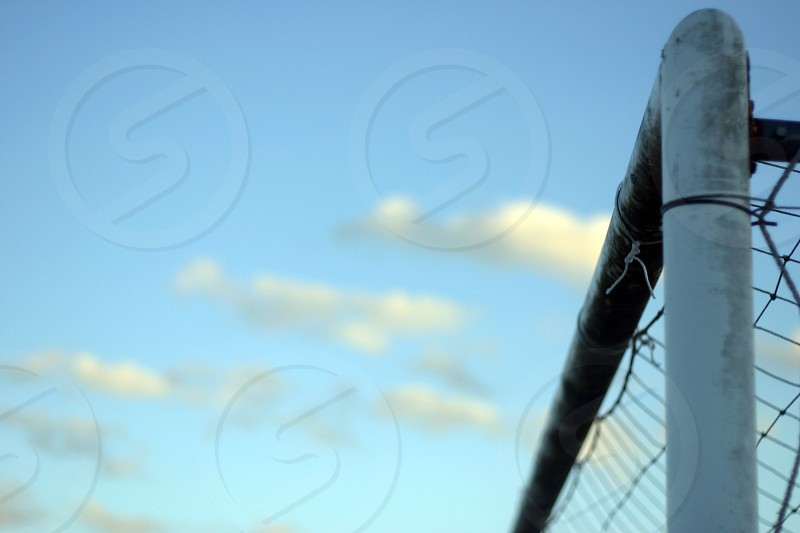 Soccer goalpost sky photo