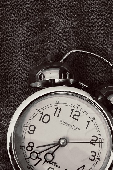 Old alarm clock time black and white photo