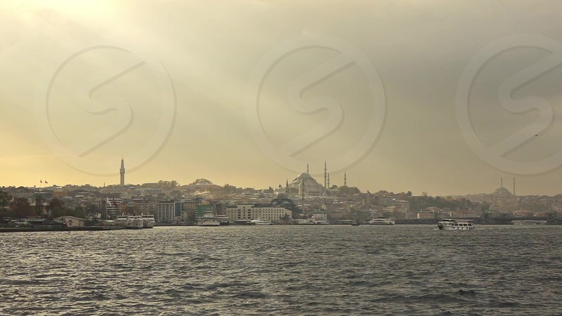 Picturesque seascape to a historical part of old sity Istanbul with Suleymaniye mosque in a sunlight at sunset sky. Slow motion Full HD video 240fps 1080p. photo