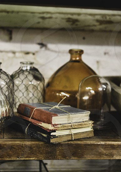 Shelf in vintage shop with vintage items. photo