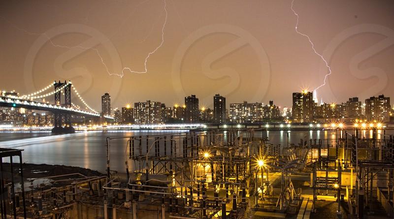 lightning strike on a city at night photo