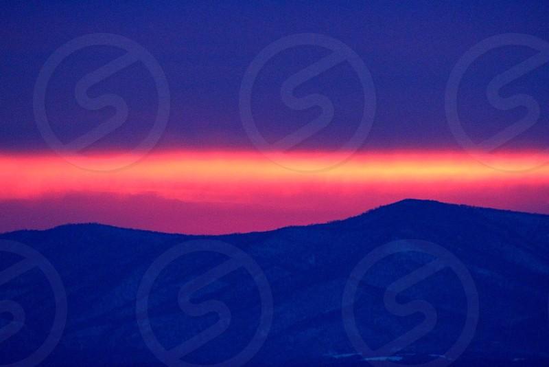 mountain tops on sunset  photo