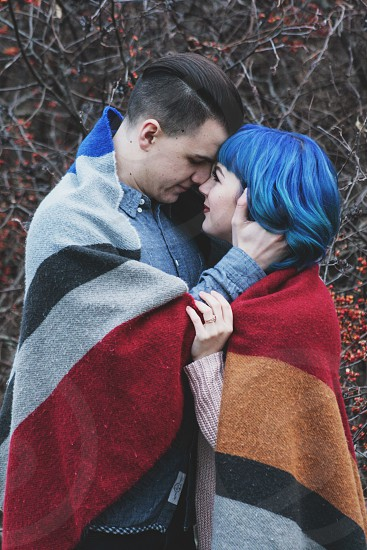 Valentines love couple marriage together passion kiss strong gentle blue red style photo