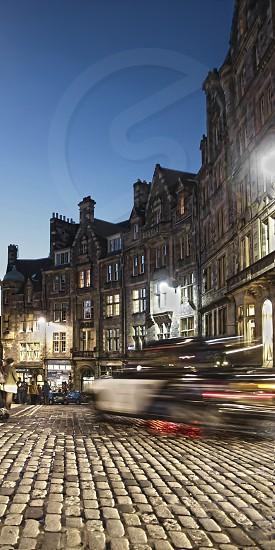 Night shot of Cockburn Street Edinburgh with blurred car movement over the cobblestones photo