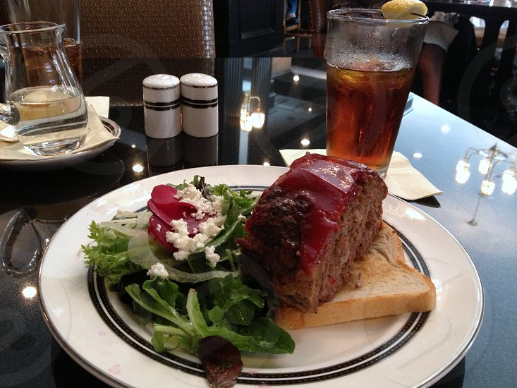 Meatloaf plate with side salad and iced tea photo