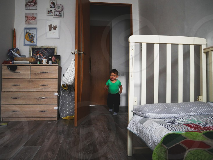 A little boy run into his room photo