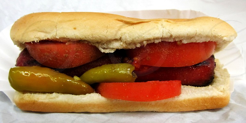 Chicago dog with peppers and tomatoes no relish photo