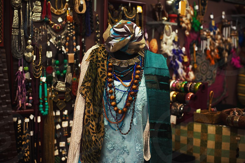 Interior of Indian shop decorated and dressed doll with jewelry and clothes.  photo