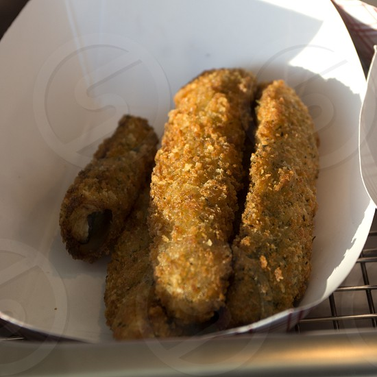 Fried pickles in paper boat fair or festival photo