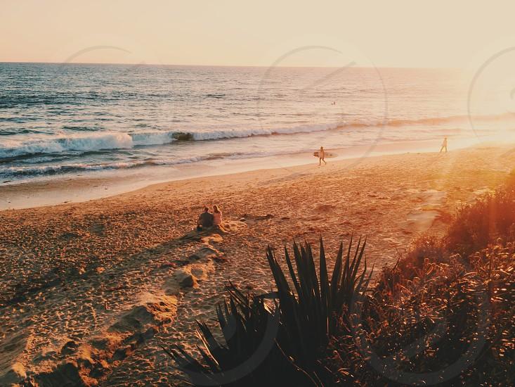 2 boy playing on seashore photo