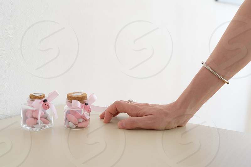 Sugared almonds and mother's hand photo