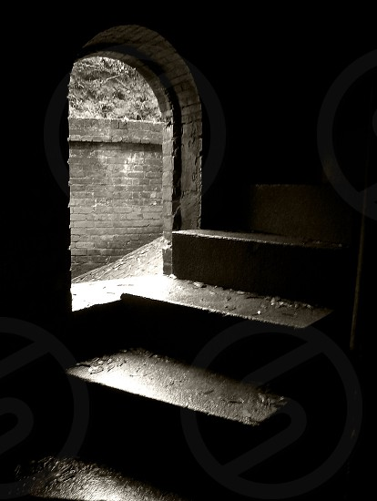 Staircase and old window in black and white photo