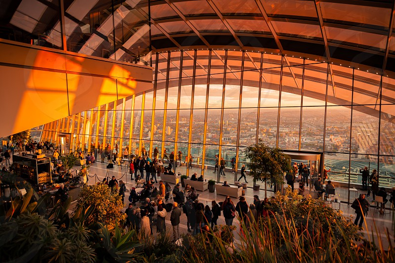 Visitors enjoiying view from Sky Garden Terraces at south London with busy Thames River. photo
