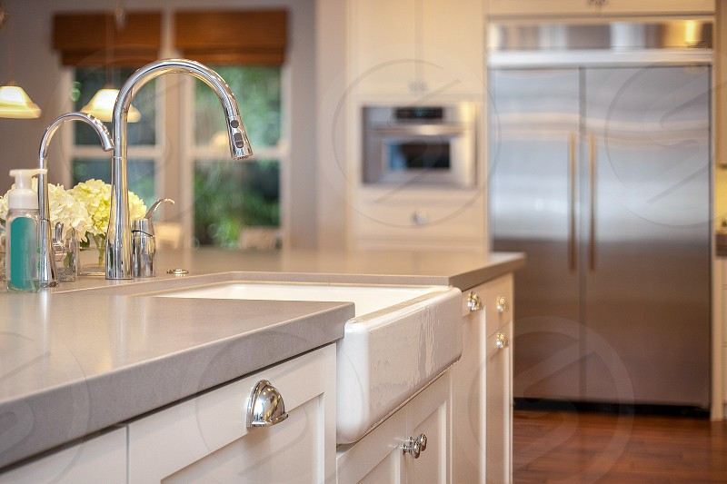 Beautiful custom contemporary residential kitchen. Island White Stainless Seating Wood Colorful Open Farmhouse Apron Sink.  photo