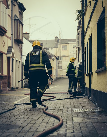 fire fighters respond to a building photo
