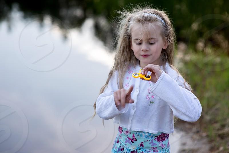 Little beautiful girl at the lake photo